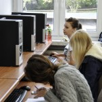 Three students sit and study using computers in the studio of the ZSP in Lublin. Clicking on the image thumbnail will display the enlarged photo.