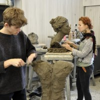 Two students sculpt heads in clay in the studio of the ZSP in Lublin. Clicking on the image thumbnail will display the enlarged photo.
