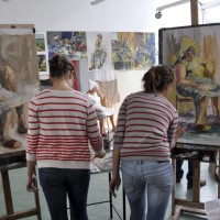 Two students are painting a portrait of a woman from a model (a woman is visible in the background) in the ZSP studio in Lublin. Clicking on the image thumbnail will display the enlarged photo.