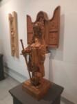 Postać kobiety z mieczem i książką. U jej stóp leży postać. Kliknięcie w miniaturkę obrazka spowoduje wyświetlenie powiększonego zdjęcia.